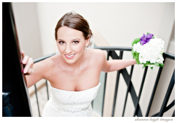 Jennifer posing for her bridal portraits at her gorgeous mediterranean style wedding venue, the Piazza in the Village in Colleyville, Texas.